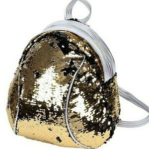Handbags - Adorable mini, flip sequin backpack! NWT